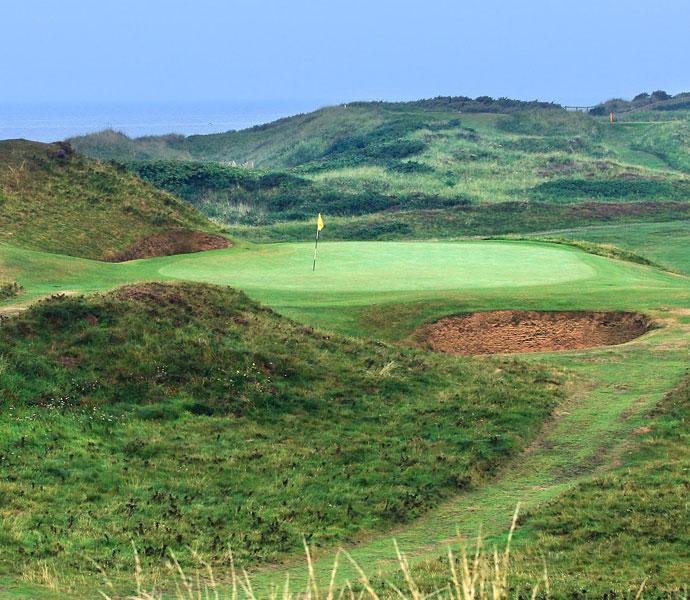 "Arnold Palmer: ""I'd pick Royal Troon as my favorite links course. I won the Open there and played particularly well that week.""                                                      Pictured: The 123-yard, par-3 8th hole known as the 'The Postage Stamp' at the Royal Troon Golf Club. Palmer won his second-straight claret jug at Troon in 1962."