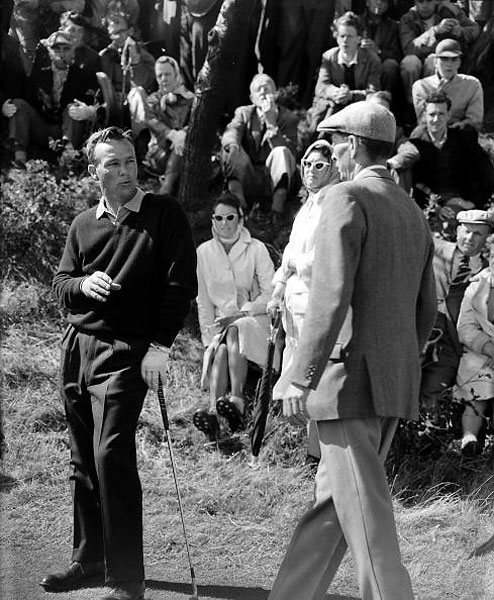 Looking perfectly nonchalant, Arnold Palmer discussed a ruling with a course official at Royal Birkdale in 1961. His V-neck and soft-collared golf shirt were not a major departure from traditional golf style, but the spirit, the attitude, was. The King went on to win the championship.
