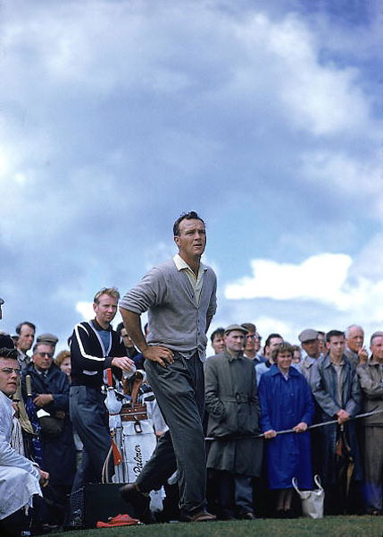 Looking positively mythic in this Sports Illustrated photo from St. Andrews in 1960, Palmer created a unique excitement with his slashing play. There was also something dashing and different about the guy, with his rolled-up sleeves and athletic, hatless frame.