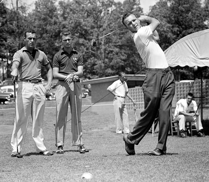 The 1950s: Arnold Palmer                        Arnold Palmer's swing with its famous helicopter finish is one of the game's most distinctive. It also generated tremendous power. Palmer used his tremendous strength to swing hard and without fear, a style that made him one of the most popular players the game has ever seen. In this photo, Palmer drives from the first tee in opening round of 17th Southern Intercollegiate golf tournament at Athens, Ga., April 29, 1954.