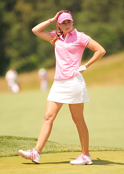"The Pink Panther Winner Paula Creamer, a panther not a tiger, gets her nickname from her predilection for pink. She went pretty classic on Sunday in an Adidas ClimaCool ""Soft Touch"" pink polo and a white ClimaCool skort. The pink shoes, also by Adidas, are in a color made just for her."