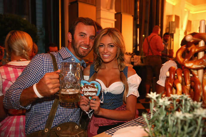 "Need more proof that life off the course is a lot more fun on the European Tour? Have a look at the 25th anniversary party of this week's BMW International Open in Munich, where players (and their significant others) dressed in traditional Bavarian clothes, milked a ""cow"" and sampled a few liters of beer.                                                      Dustin Johnson and Paulina Gretzky."