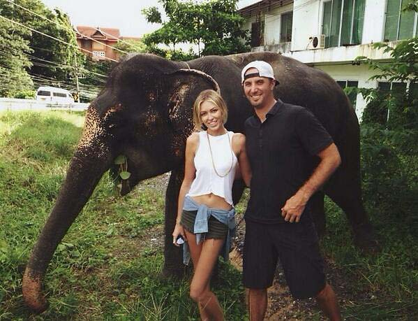 "Paulina posted this picture of her and Dustin Johnson in Thailand on her Twitter. ""Found a new friend on the side of the road."""