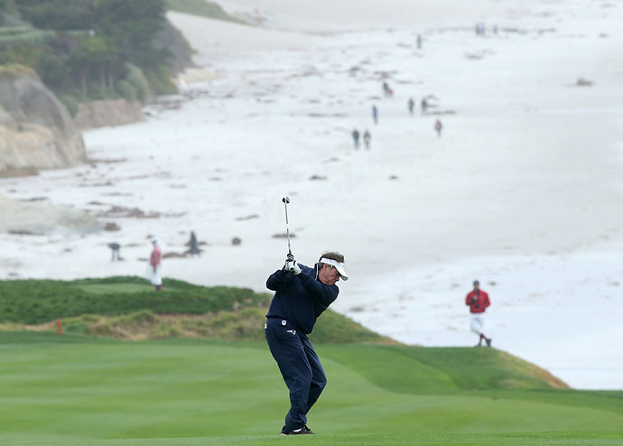 New England Patriots head coach Bill Belichick plays a shot on the ninth fairway during the third round of the AT&T Pebble Beach National Pro-Am at the Pebble Beach Golf Links on Saturday.