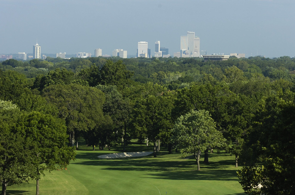 No. 1                        464 Yards, Par 4                       The elevated first tee at Southern Hills features a great view of Tulsa in the distance. The hole has a slight dogleg to the left and players must avoid the fairway bunkers on the right. The second shot should be a mid- or short iron to a green that tilts from front to back and has three bunkers to protect it.