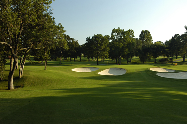 No. 17                        358 Yards, Par 4                       After playing the longest par 4 at Southern Hills, players will face the shortest. The hole doglegs right, and missing right brings trees and a creek into play, so big numbers are possible. The ideal tee shot is to the fairway's left side, leaving only a short-iron second shot to the shallow, two-tiered green. As you can see at left, missing this green short is not a good idea.