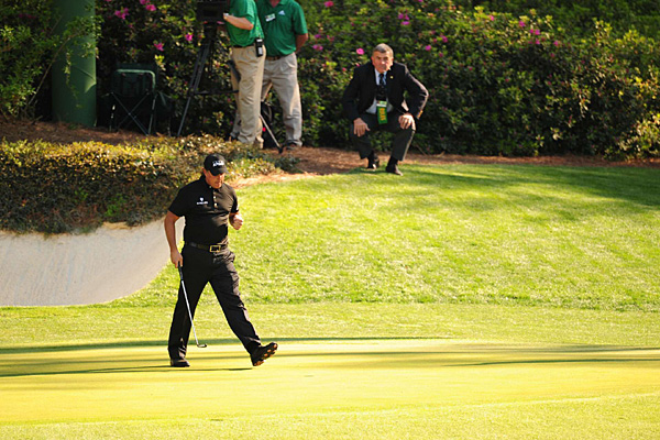 Mickelson got his back-nine charge started with a long putt for birdie at the par-3 12th.