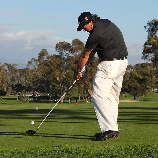 At impact, Mickelson is maintaining his posture, making ball striking easier and more consistent.