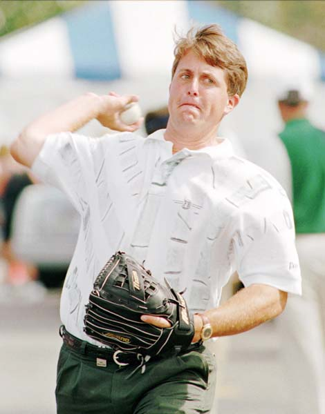 Phil Mickelson grimaces as he throws a baseball to his caddie in the parking lot Saturday morning March 18, 1995 at the Nestle Invitational Golf Tournament in Orlando, Fla. Mickelson, whose two day total was 2-over-par 146, was waiting to see if he made the cut. He missed it by one stroke.
