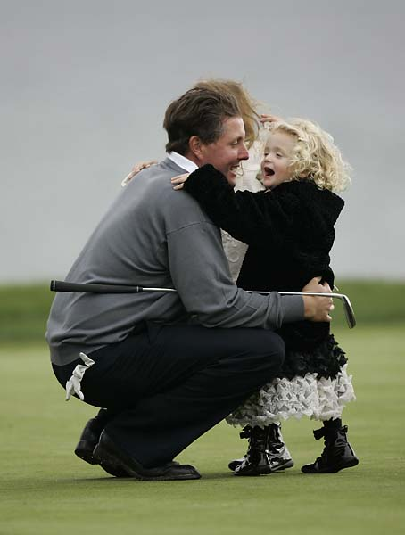 Phil Mickelson is hugged by his daughter Sophia during the final round of the 2005 AT&T Pebble Beach National Pro-Am at Pebble Beach Golf Club in Pebble Beach, California on February 13, 2005. Mickelson won the event by four strokes at -19 par.