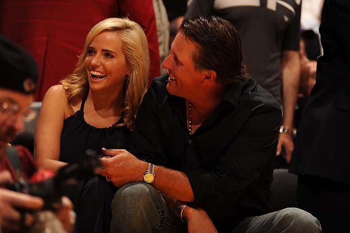 Phil Mickelson and his wife Amy at a Rockets-Lakers playoff game at the Staples Center in May 2009.