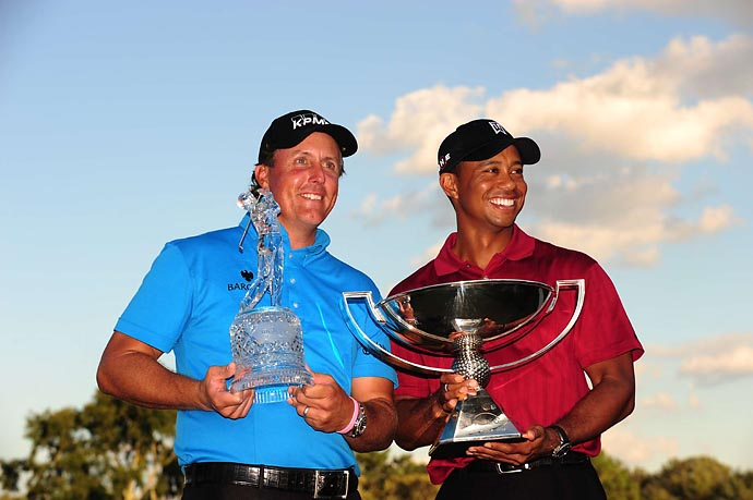 Trophy envy? Phil Mickelson holds his Tour Championship trophy while Tiger Woods has the $10 million FedEx Cup at Atlanta's East Lake in September 2009.