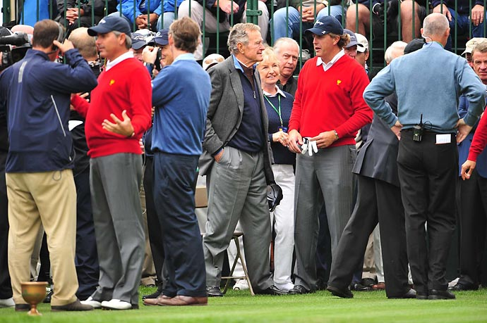 Phil Mickelson and former President George H.W. Bush chat at the 2009 Presidents Cup at Harding Park Golf Club in San Francisco.