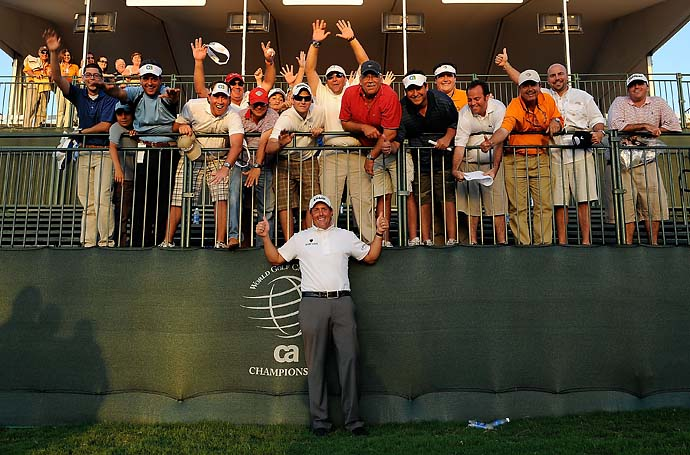 Phil Mickelson celebrates with a group of fans after winning the World Golf Championships-CA Championship at the Doral Golf Resort & Spa on March 15, 2009, in Miami, Fla.