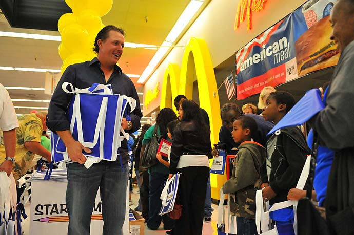 Phil Mickelson greets Wal-Mart shoppers at a back-to-school shopping spree in San Diego in August 2010.