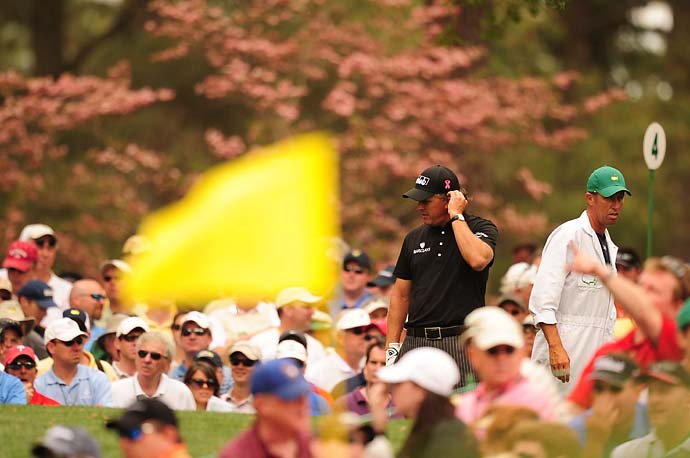 Phil Mickelson and caddie Jim Mackay on the fourth tee at Augusta National, Mickelson's home away from home, at the 2010 Masters.