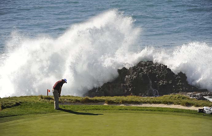 Phil Mickelson chips on the 7th green during the final round of the AT&T Pebble Beach National Pro-Am at Pebble Beach Golf Links on February 14, 2010 in Pebble Beach.