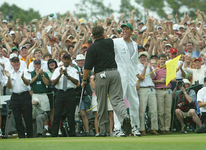 Another view of the classic shot. Phil Mickelson celebrates with his caddie Jim MacKay after his birdie to win the Masters by one shot on the 18th green during the final round of the Masters at the Augusta National Golf Club on April 11, 2004, in Augusta, Ga.