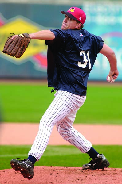 Phil Mickelson throws a pitch during batting practice with the Toledo Mud Hens, the Triple-A affiliate of the Detroit Tigers, in August 2003.
