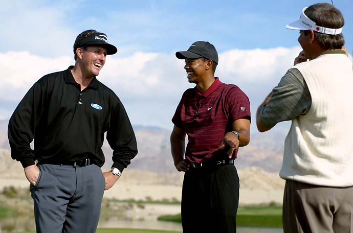 Phil Mickelson, Tiger Woods and Fred Couples share a laugh on the 18th green following completion of the Skins Game on December 1, 2002 at the Landmark Golf Club in Indio, California.