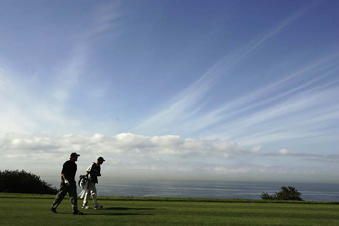 Phil Mickelson walks with caddie Jim McKay alongside of the Pacific Ocean on the fourth hole during the first round of the Buick Invitational at the Torrey Pines Golf Course on January 26, 2006 in La Jolla, California.