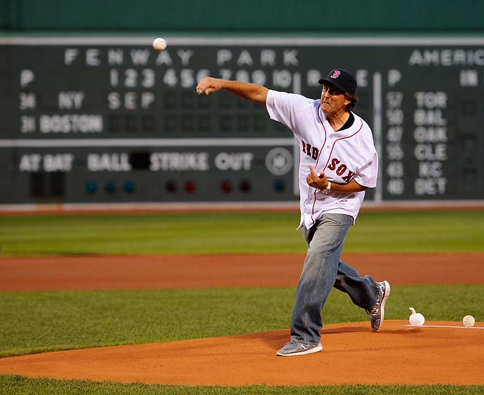 Phil Mickelson throws out the first pitch before the start of the game between the New York Yankees and the Boston Red Sox at Fenway Park in Boston in September 2011.