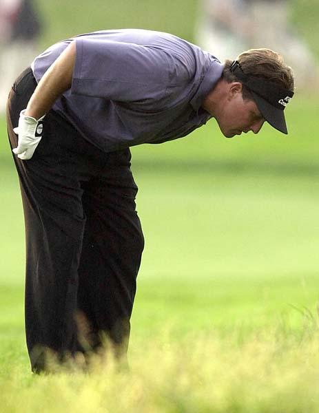 Phil Mickelson looks at his ball in the rough on the 16th hole during the final round of the U.S. Open Golf Championship at the Black Course of Bethpage State Park in Farmingdale, N.Y., Sunday, June 16, 2002.  Mickelson, who bogeyed the hole, finished three strokes behind Tiger Woods, who won the championship.