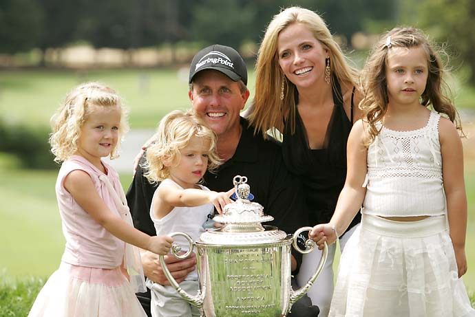 Phil and Amy Mickelson celebrate Phil's win at the 2005 PGA Championship with their family.