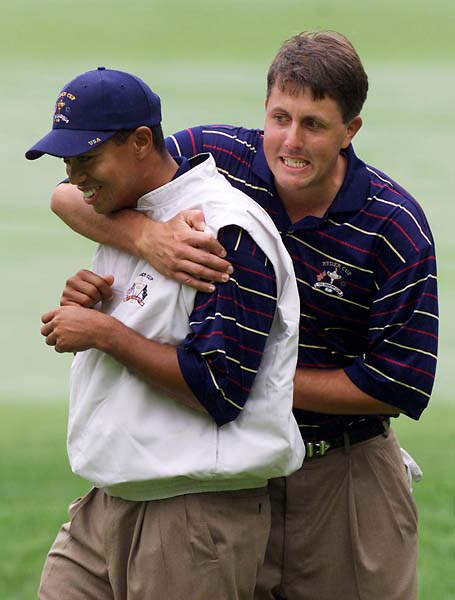 Phil Mickelson and Tiger Woods joke around at the 1999 Ryder Cup.