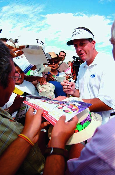 Fan-friendly Phil Mickelson signs a few autographs off the 18th green during the practice round of the EMC World Cup at the Vista Vallarta Club de Golf on Dec. 11, 2002, in Puerto Vallarta, Mexico.