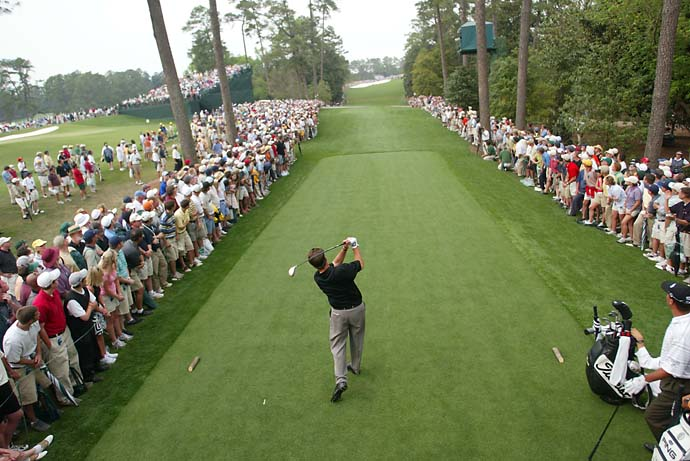 Teeing off into history. Phil Mickelson hits his tee shot on 18 on Sunday at the 2004 Masters.