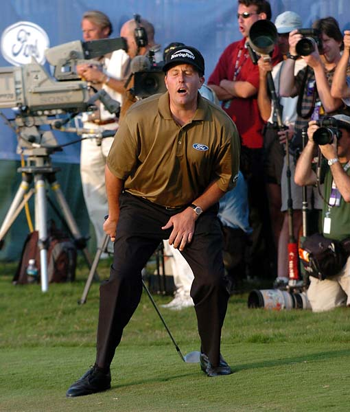 Phil Mickelson reacts after missing a putt on the 18th hole to at the Ford Championship at Doral in Miami, Florida on March 6, 2005. Tiger Woods defeated Mickelson by one stroke.