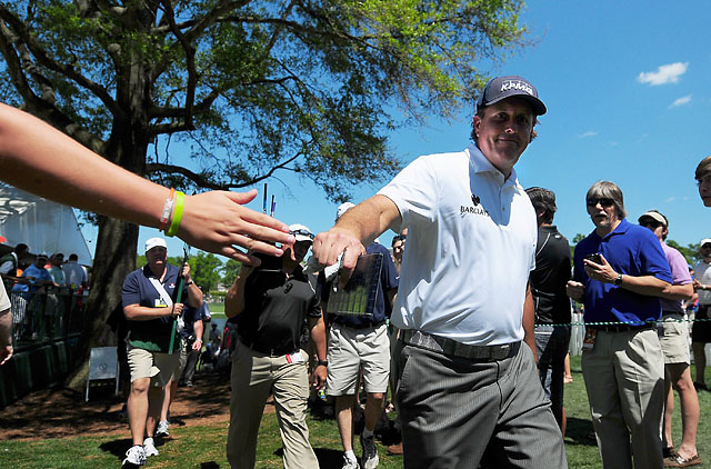A fan greets Mickelson at Quail Hollow on Saturday.