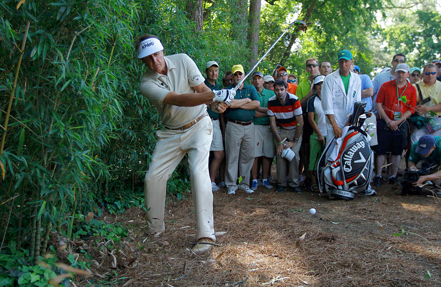 Mickelson was forced to play two shots right handed as he tried to get out of trouble.