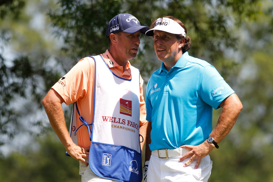 "Phil Mickelson talked strategy with his caddie, Jim ""Bones"" Mackay."
