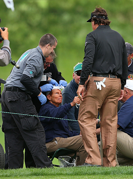 Mickelson checked on a fan who was hit on the head by one of Lefty's errant shots.