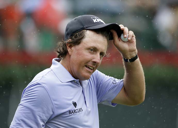 Phil Mickelson acknowledges his many fans at the Tour Championship on Saturday.