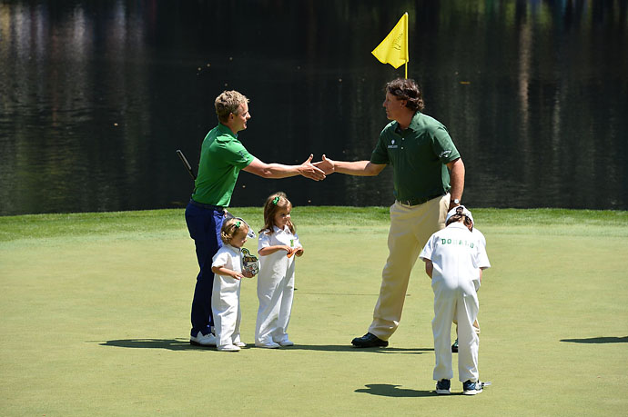 Phil Mickelson and Luke Donald shake hands on the ninth green at the Par 3 Contest on Wednesday.