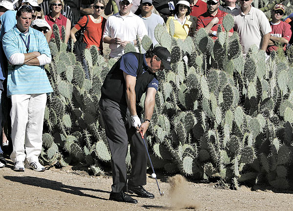 Phil Mickelson's first tournament of 2009 got off to a less-than-stellar start with a double bogey on the first hole.