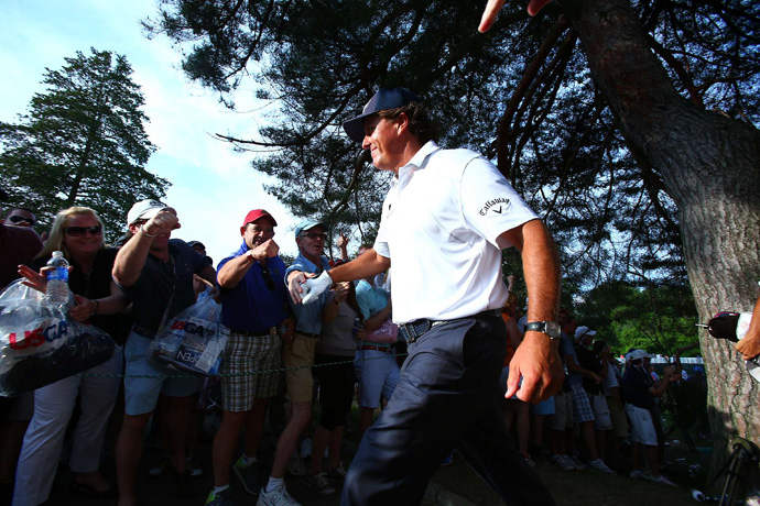 Mickelson made sure to dish out fist bumps to his fans.