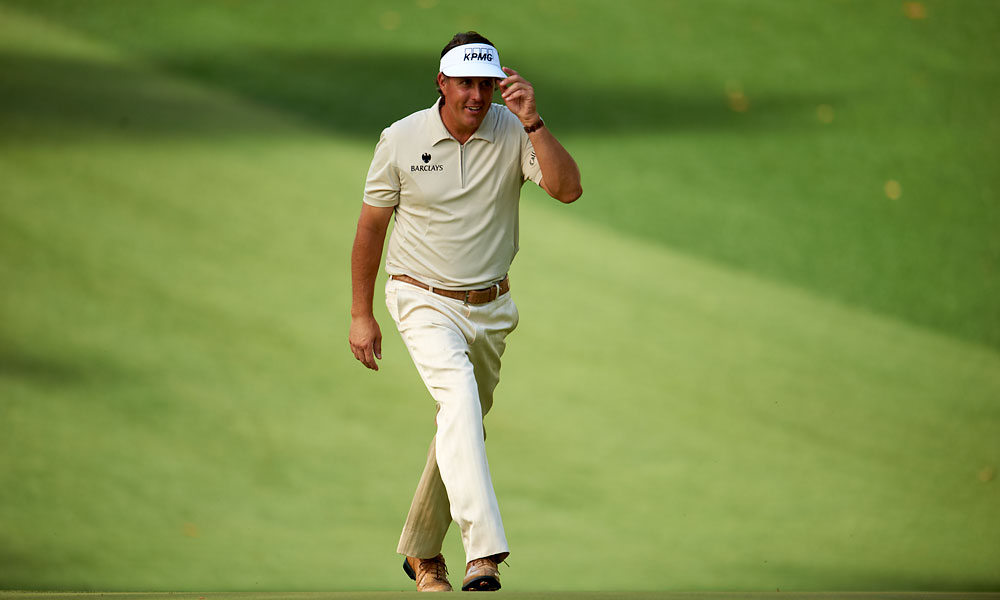 Zip Drive                           The modern polo shirt often has a zip collar instead of buttons, as in this well-fitted beige one worn Sunday by Phil Mickelson. It went perfectly with his ecru trousers, tan belt and tan shoes.