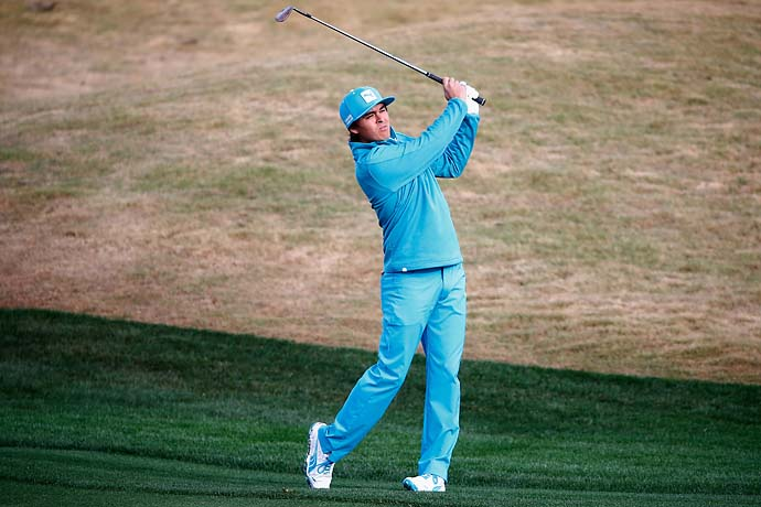 Rickie Fowler looks smurfy during the first round of the Waste Management Phoenix Open at TPC Scottsdale