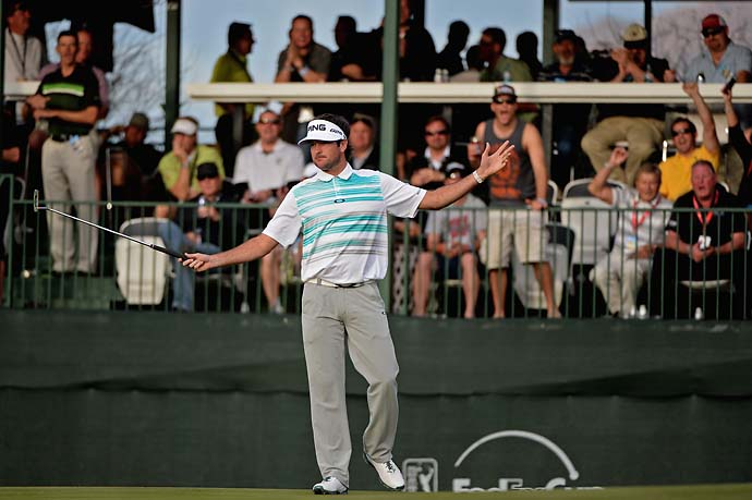 Bubba Watson celebrates a birdie on the 16th hole during the first round of the Waste Management Phoenix Open.