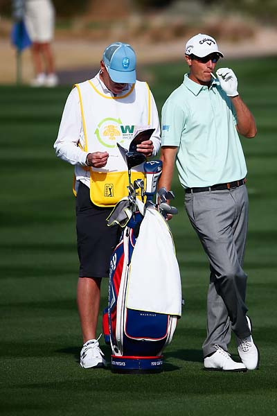 Nicolas Colsaerts smokes on the 14th hole during the first round of the Waste Management Phoenix Open.