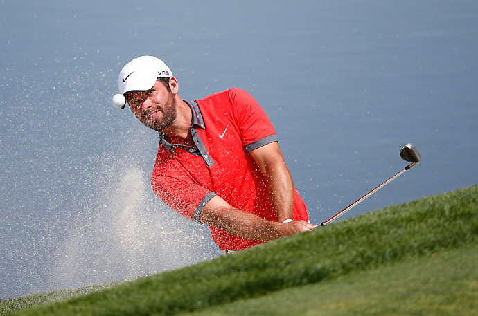 Paul Casey plays his third shot on the 11th hole during the third round of the Memorial Tournament. Casey shot 76 on Saturday.