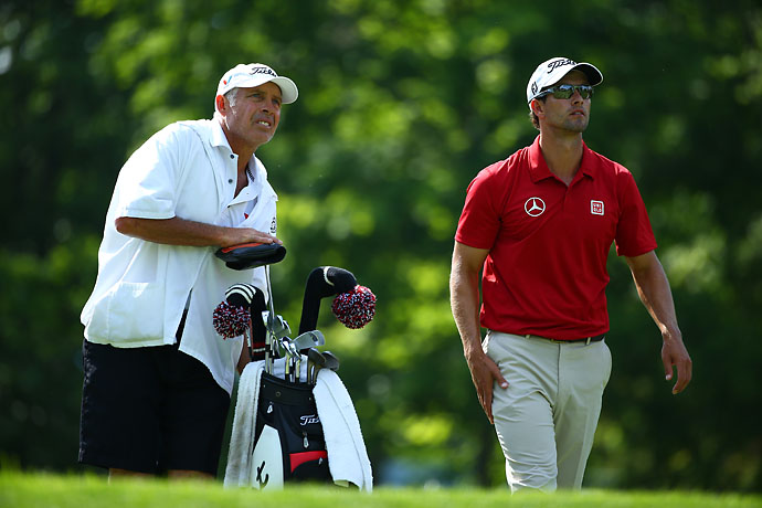 Adam Scott and caddie Steve Williams  look on from the 18th tee box during the third round of the Memorial Tournament. Scott shot 68 on Saturday.