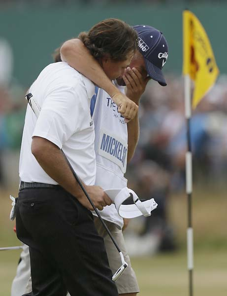 Phil Mickelson and an emotional Bones Mackay celebrate on the 18th green at Muirfield after Mickelson's British Open win.