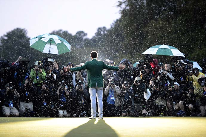 Greet the Press: Adam Scott poses for photographers after winning the 2013 Masters.