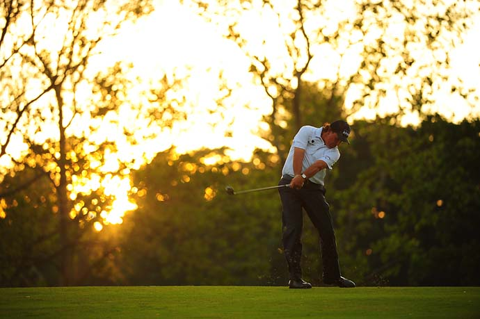 Phil Mickelson follows the sun in during a late afternoon round on Saturday at the U.S. Open at Merion.
