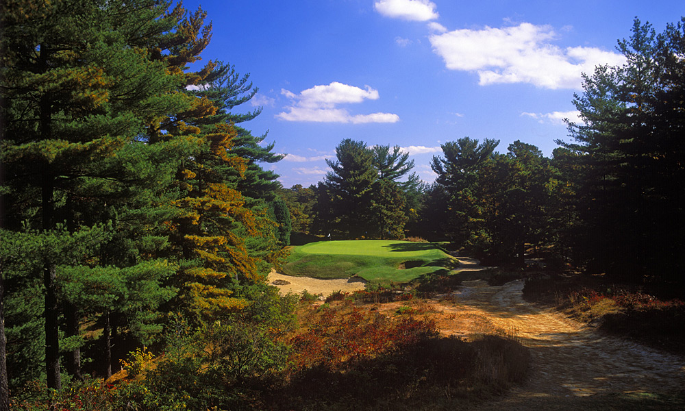 "Tee shot at the 145-yard, par-3 10th at Pine Valley -- Pine Valley, N.J.Two words: ""Devil's Asshole."" OK, a few more words: it's the deep pot bunker that guards this tiny, treacherous target. Call it purgatory if you miss the green."